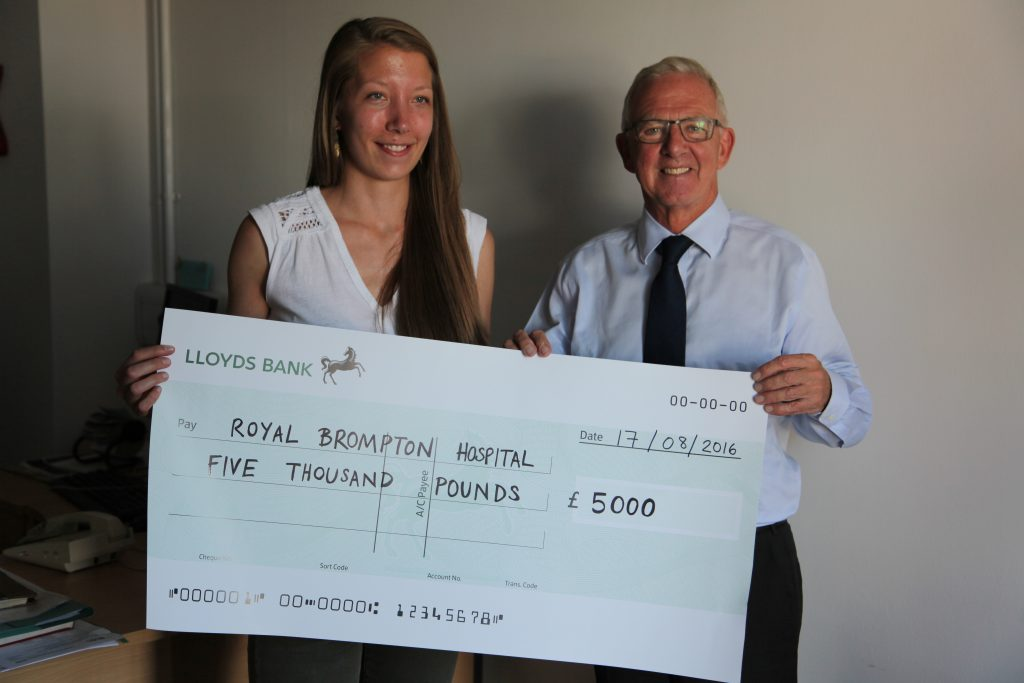 Helen presents Dr Shore with cheque
