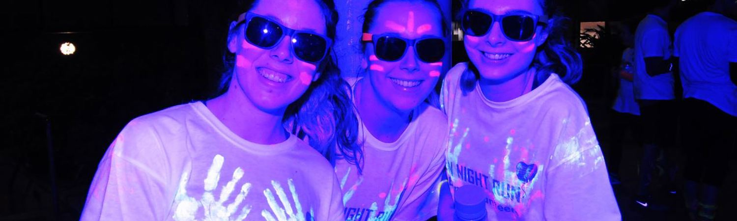 Glowing for gold: Runners don neon paint and dash 5k to buy patient virtual reality kits